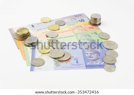 Malaysian ringgit coins and notes on white background