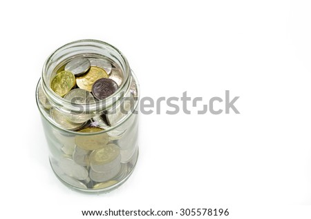 Malaysian Ringgit coins in glass jar for emergency fund, retirement plan, house, education, future. Isolated on white background
