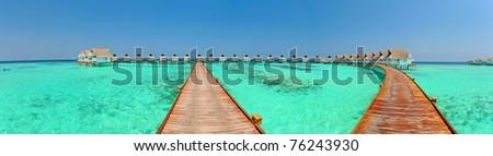 Maldive water villa - bungalows Panorama - stock photo