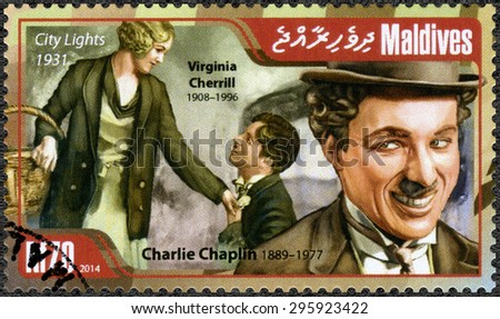 MALDIVES - CIRCA 2014: A stamp printed in Maldives shows portrait of Charlie Chaplin (1889-1977) and Virginia Cherrill (1908-1996), film City Lights, 1931, circa 2014 - stock photo
