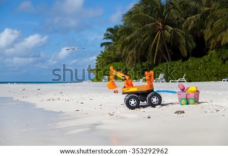 Maldives, excavator on the beach  - stock photo