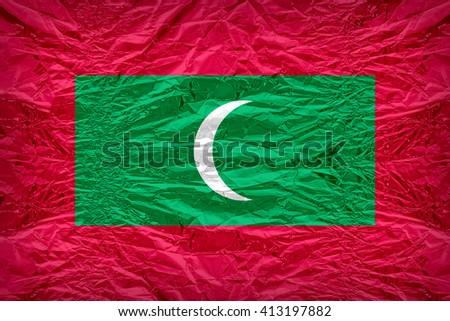 Maldives flag pattern overlay on floyd of candy shell, vintage border style - stock photo