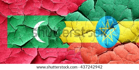 Maldives flag with Ethiopia flag on a grunge cracked wall - stock photo