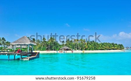 Maldives island and blue sea - stock photo