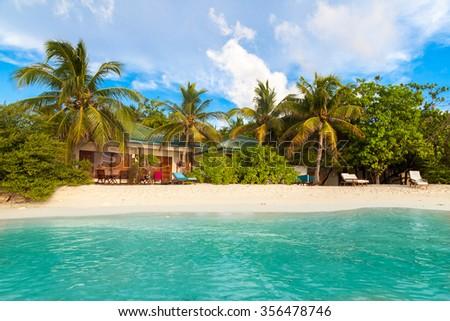 Maldives, tropical paradise, villas by the beach  - stock photo