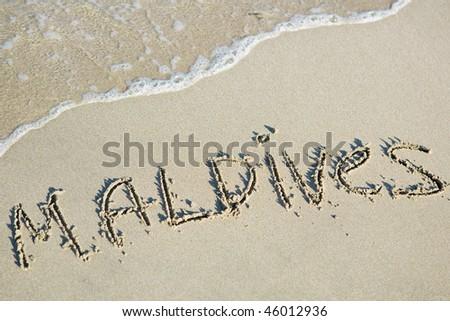 Maldives written on the sand - stock photo