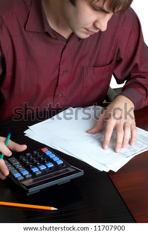 male accountatn accountant working with papers and calculator