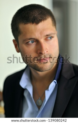 Male actor headshot showing action movie charackter - stock photo