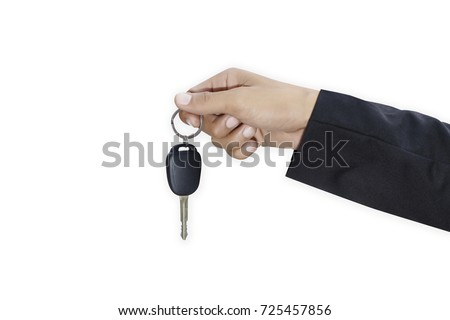Male adult businessman in a suit  and holding a car key in his h