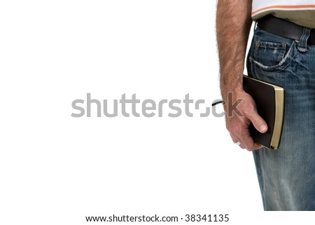 Male adult missionary holding bible at his side. - stock photo