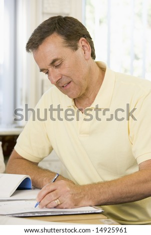 Male adult student studying on campus - stock photo