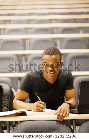 male african american college student in lecture hall - stock photo
