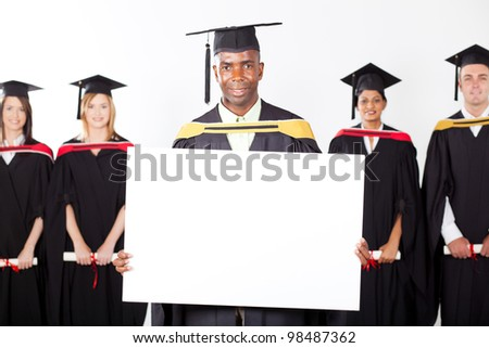 male african graduate with white board - stock photo