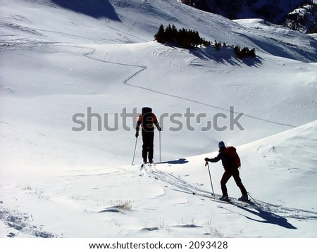 male and female beginning ski descent - stock photo