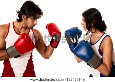 "Male and female boxers ""Battle of the sexes"". Studio shot over white."
