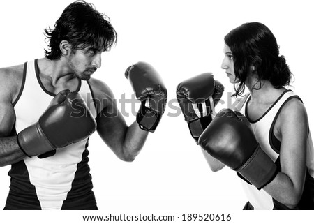 "Male and female boxers ""Battle of the sexes"". Studio shot over white. - stock photo"