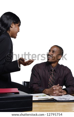 Male and female business colleagues laughing as they chat together. Vertical shot isolated against a white background.