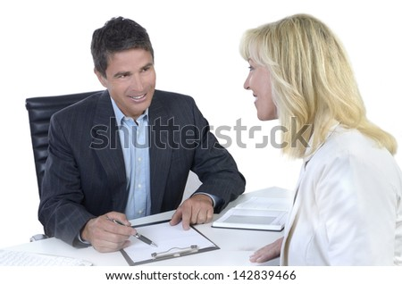 Male and female business people negotiating, Studio Shot