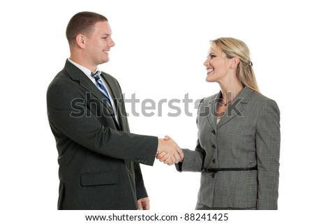 Male and female business people shaking hands isolated on a white background - stock photo