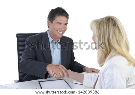 Male and female business people shaking hands, Studio Shot