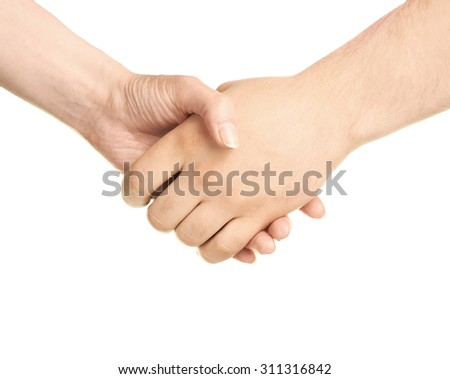 Male and female caucasian hands holding each other in a handshake isolated over the white background