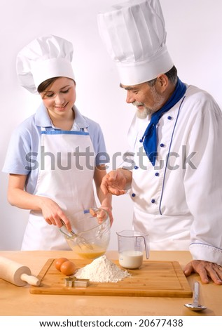 male and female chef together in the kitchen - stock photo