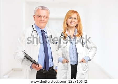 Male and female doctor standing in a hall of a clinic