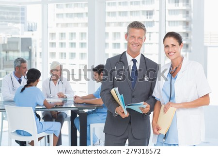Male and female doctors with reports in the hospitals - stock photo