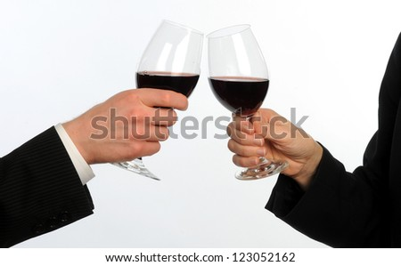 Male and female executives toast with wine glasses