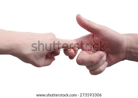 Male and female hands are together isolated on a white background.  Fingers in the lock as a token of friendship