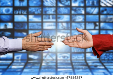 male and female hands shaking, concept for social internet network