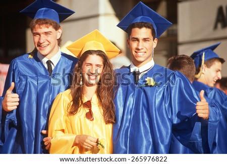Male and female high school graduates, Providence, RI - stock photo