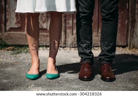 Male and female legs - stock photo