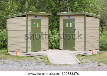 Male and Female outdoor restroom facilities with handicapped accessibility. - stock photo