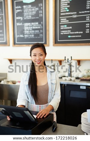 Male And Female Staff In Coffee Shop