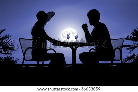 Male and feminine silhouettes moon in the night - stock photo