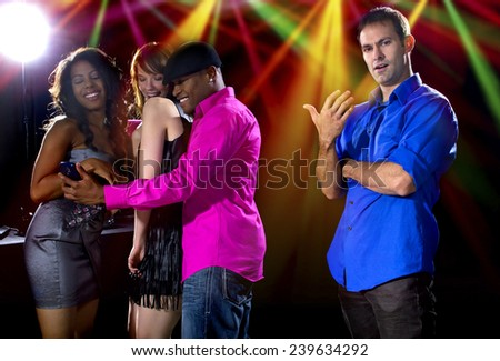 male and women rudely interrupted by a flirting pickup artist at a bar  - stock photo