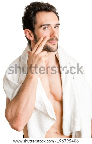 Male applying moisturizer to her face, isolated in white - stock photo