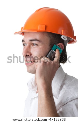 Male architect in a hard hat talks by a mobile phone on a white background. - stock photo