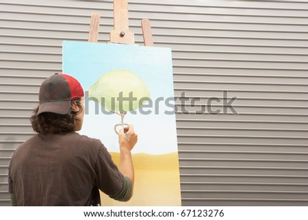 Male artist painting - stock photo