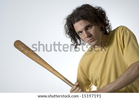 Male athlete holding a baseball bat and looking at the camera.  Horizontally framed shot. - stock photo