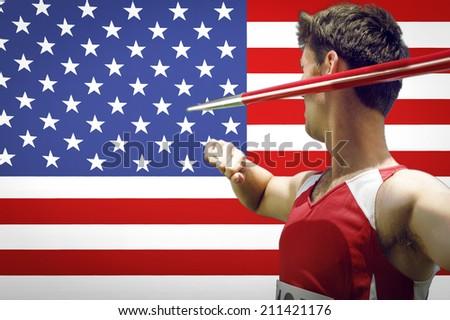 Male athlete holding javelin - stock photo