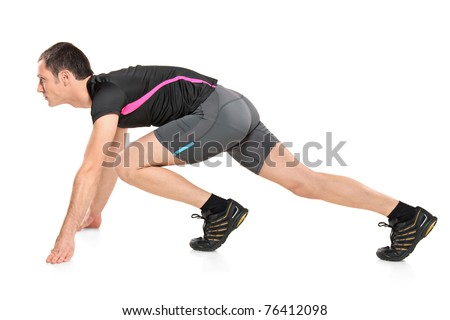 Male athlete ready to run isolated on white background