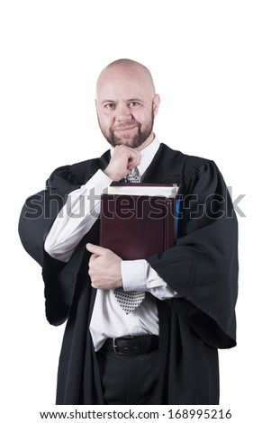 male bald  attorney in black robe standing with book - stock photo