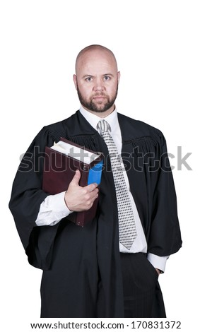 male bald  attorney with a beard in black robe holding a legal book - stock photo