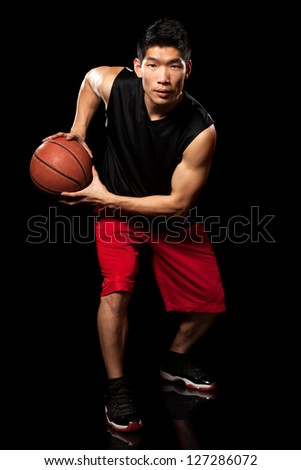 Male basketball player. Studio shot over black. - stock photo