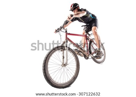 Male bicyclist riding a very dirty mountain bike downhill style  - stock photo