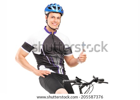 Male biker sitting on his bike and holding a bottle isolated on white background - stock photo