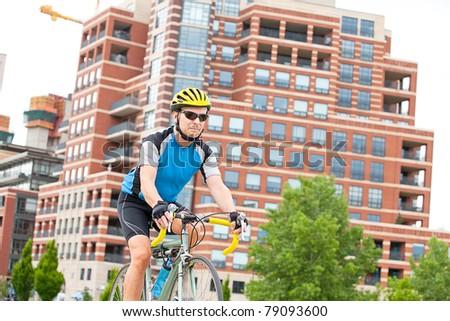 Male bikje rider in the park - stock photo