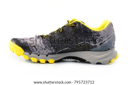 Male black and yellow sport sneakers with grey sole isolated on a white backgrond